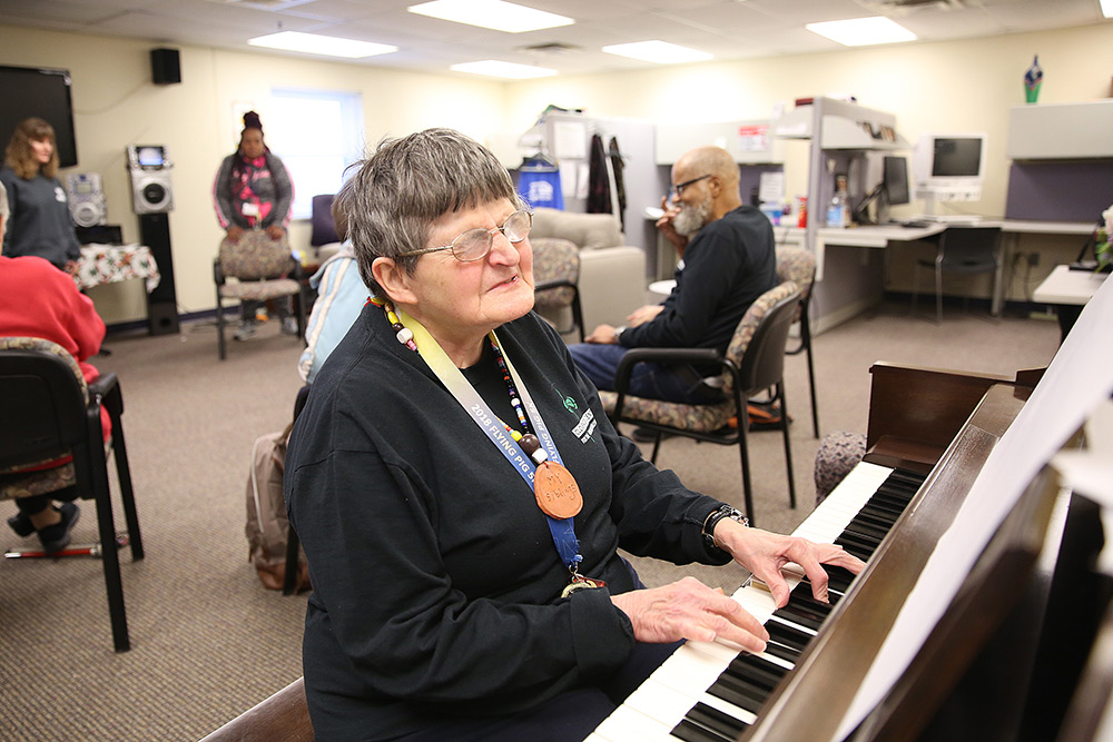 woman who is visually impaired playing piano at Clovernook Center