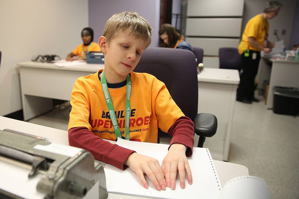 A young man competes in one of the challenges at the Ohio Regional Braille Challenge in 2019.