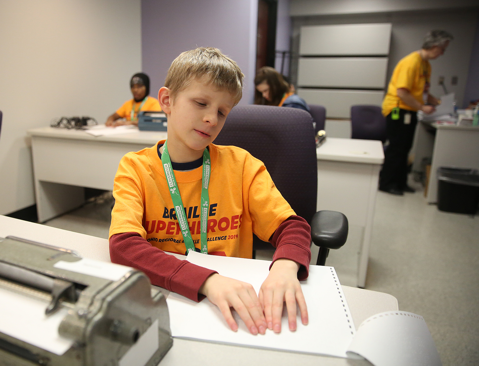 Philip Sotak participates in the Ohio Regional Braille Challenge, working his way through a proofreading test.
