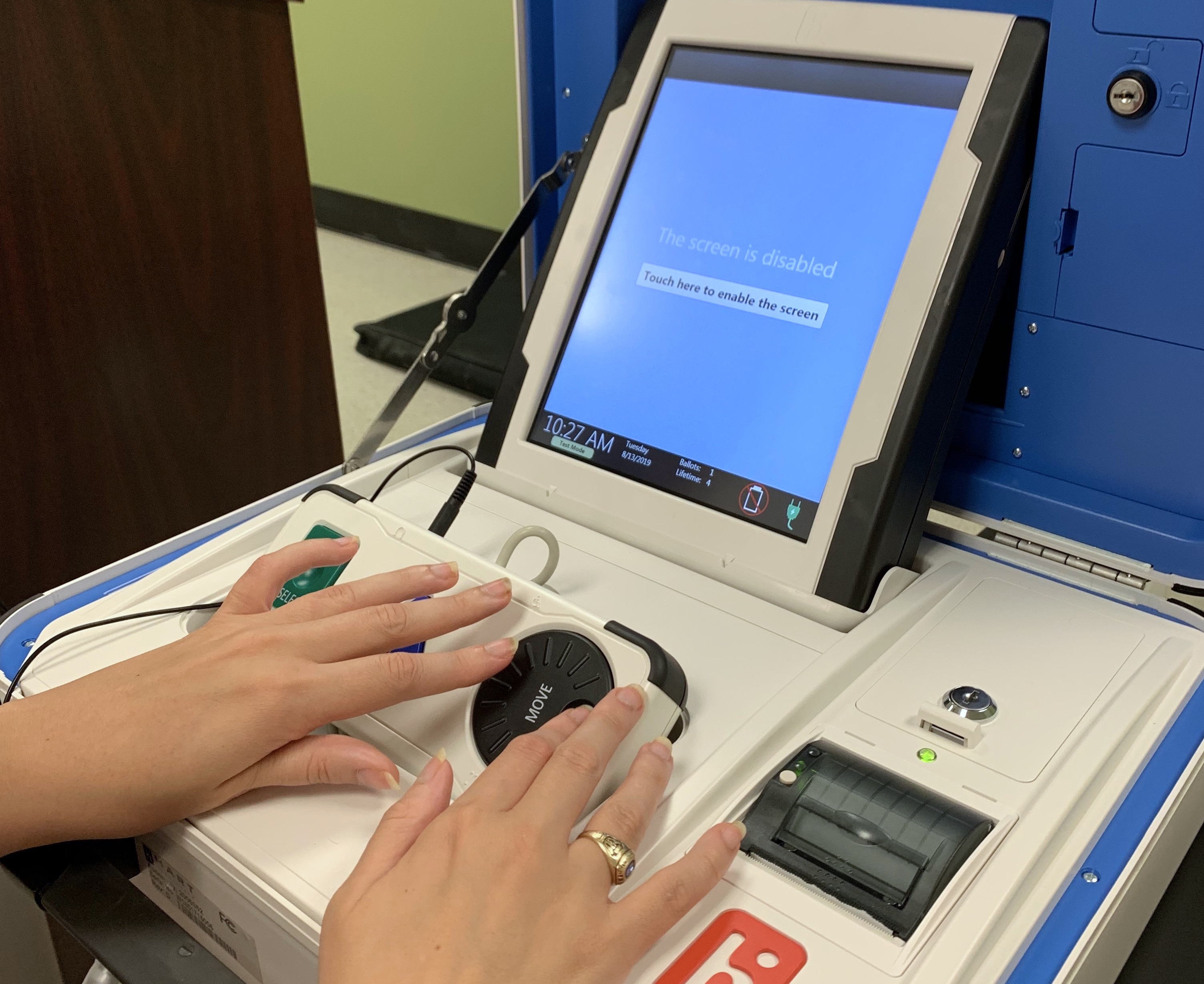 A Clovernook Center employee with visual impairment tests the new accessible voting machine at Clovernook Center.