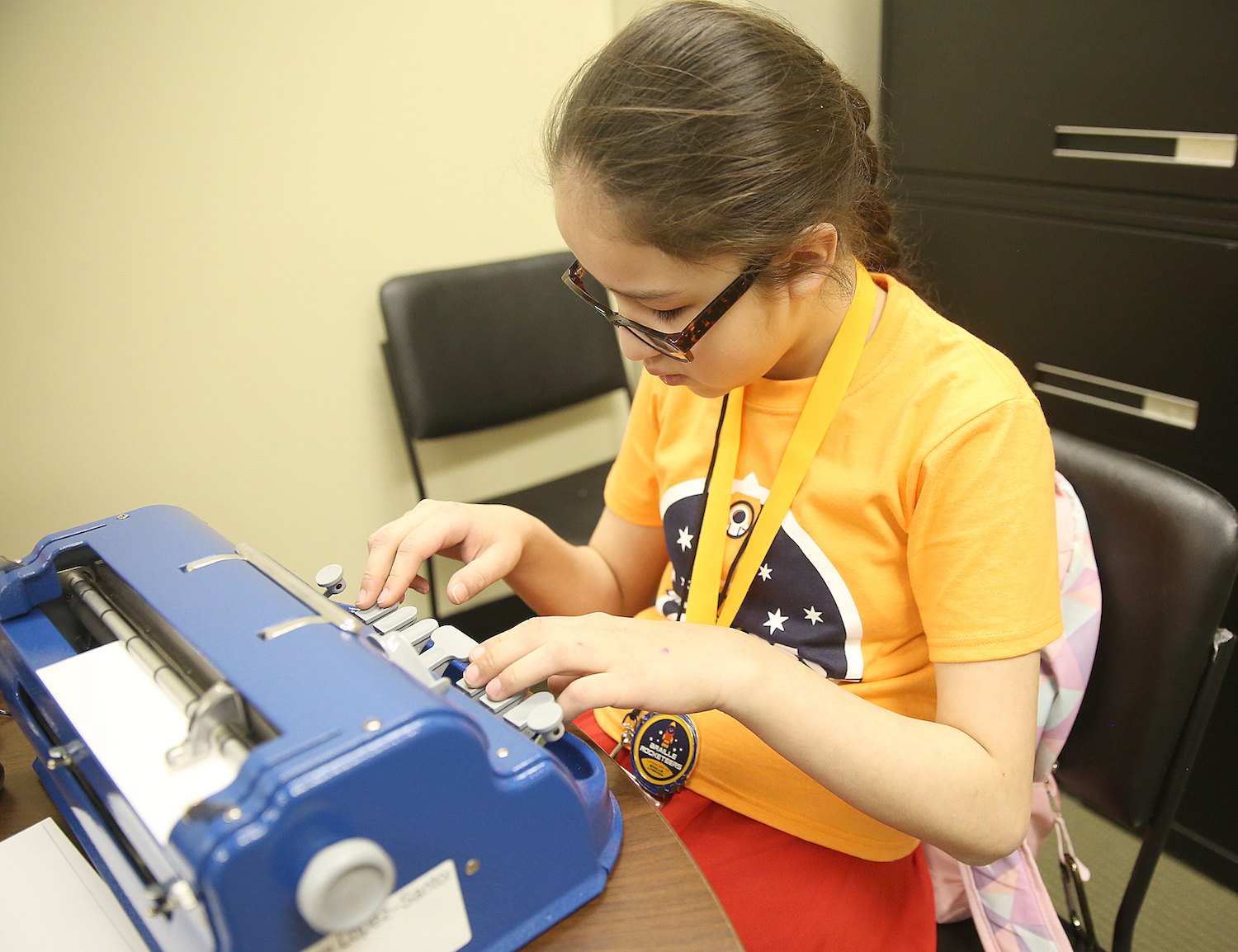 A student participates in a challenge activity with her brailler at the Ohio Regional Braille Challenge.