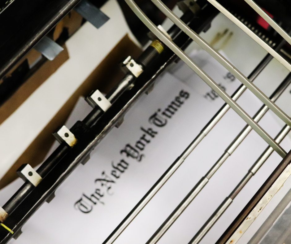 New York Times print title pages being embossed with braille on an adapted Heidelberg press.